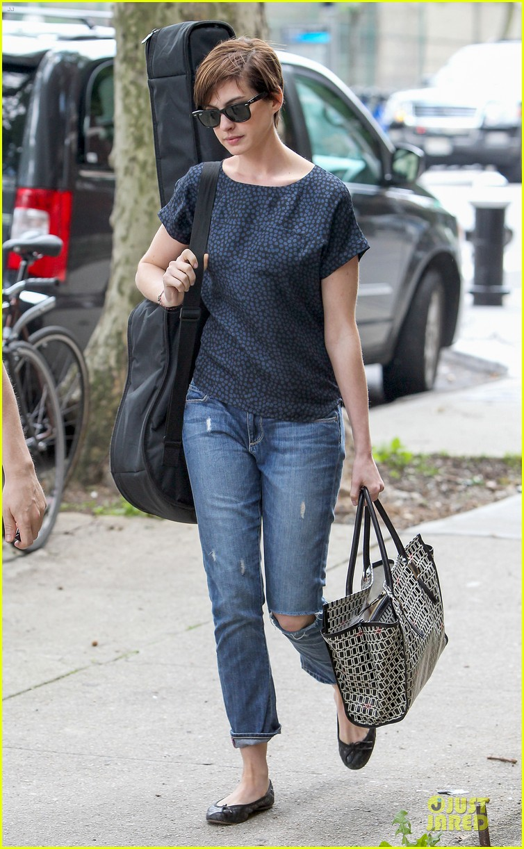 anne hathaway guitar carrying gal on song one set 182890162