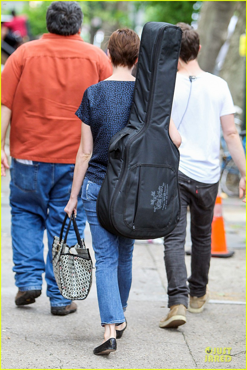 anne hathaway guitar carrying gal on song one set 242890168