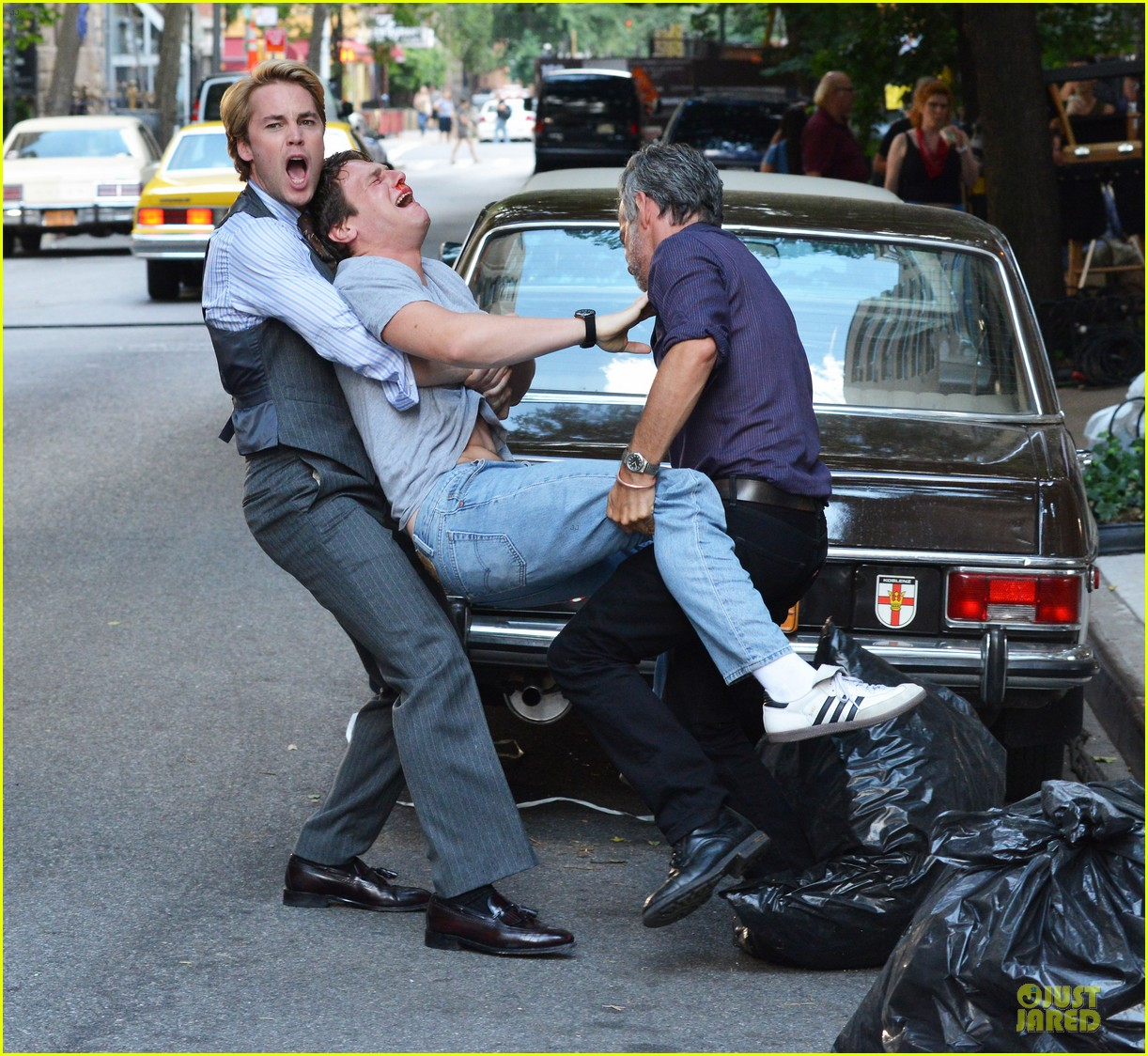 taylor kitsch carries a crying man for normal heart 032900223