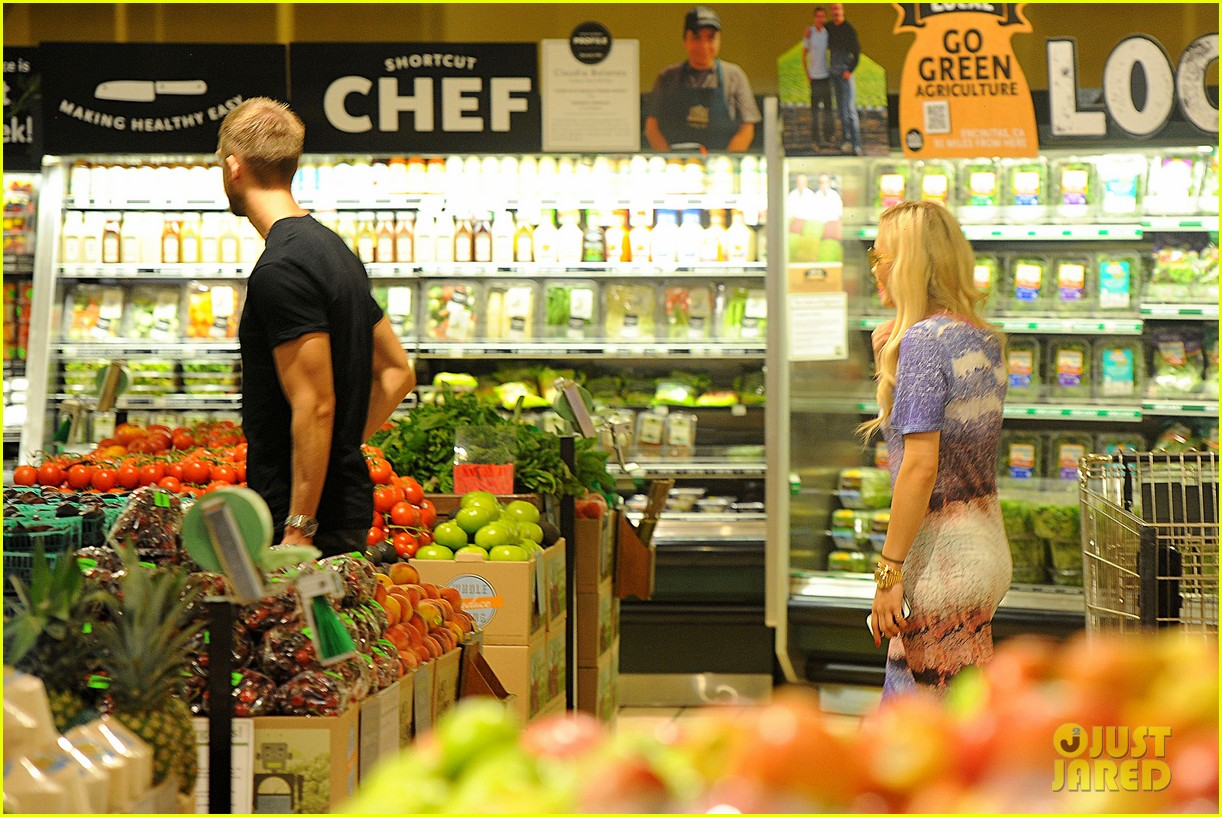 rita ora calvin harris cuddle up at whole foods 19
