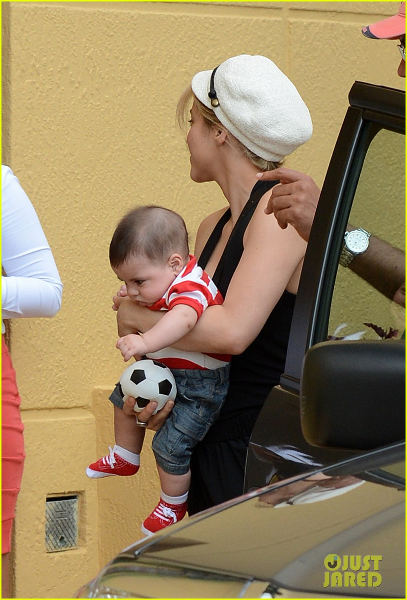 shakira carries toy soccer ball for baby milan 022886357