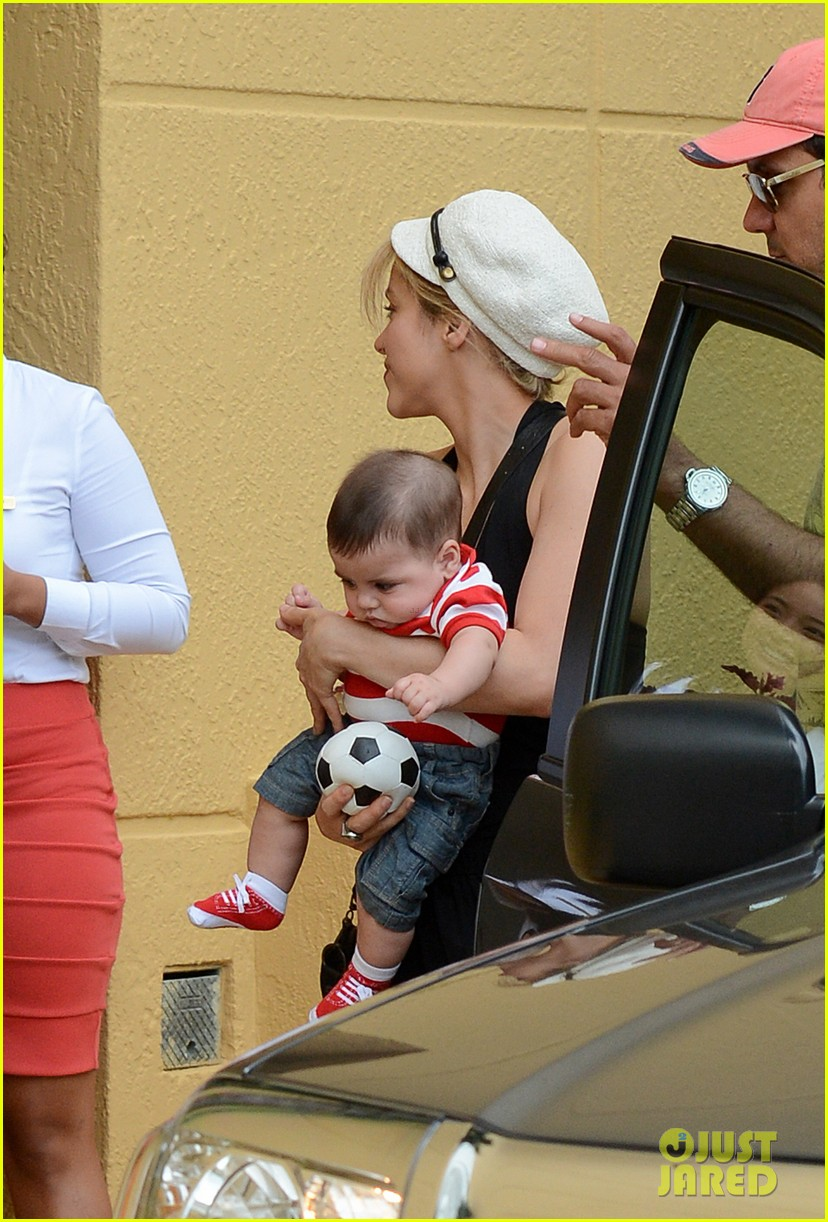 shakira carries toy soccer ball for baby milan 042886359