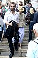 tilda swinton sandro kopp hold hands in venice 21