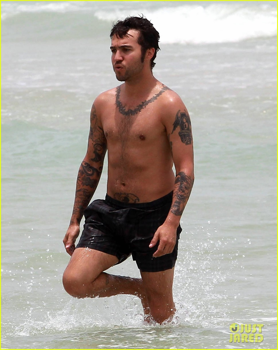 pete wentz shirtless beach day with bronx meagan camper 352886463