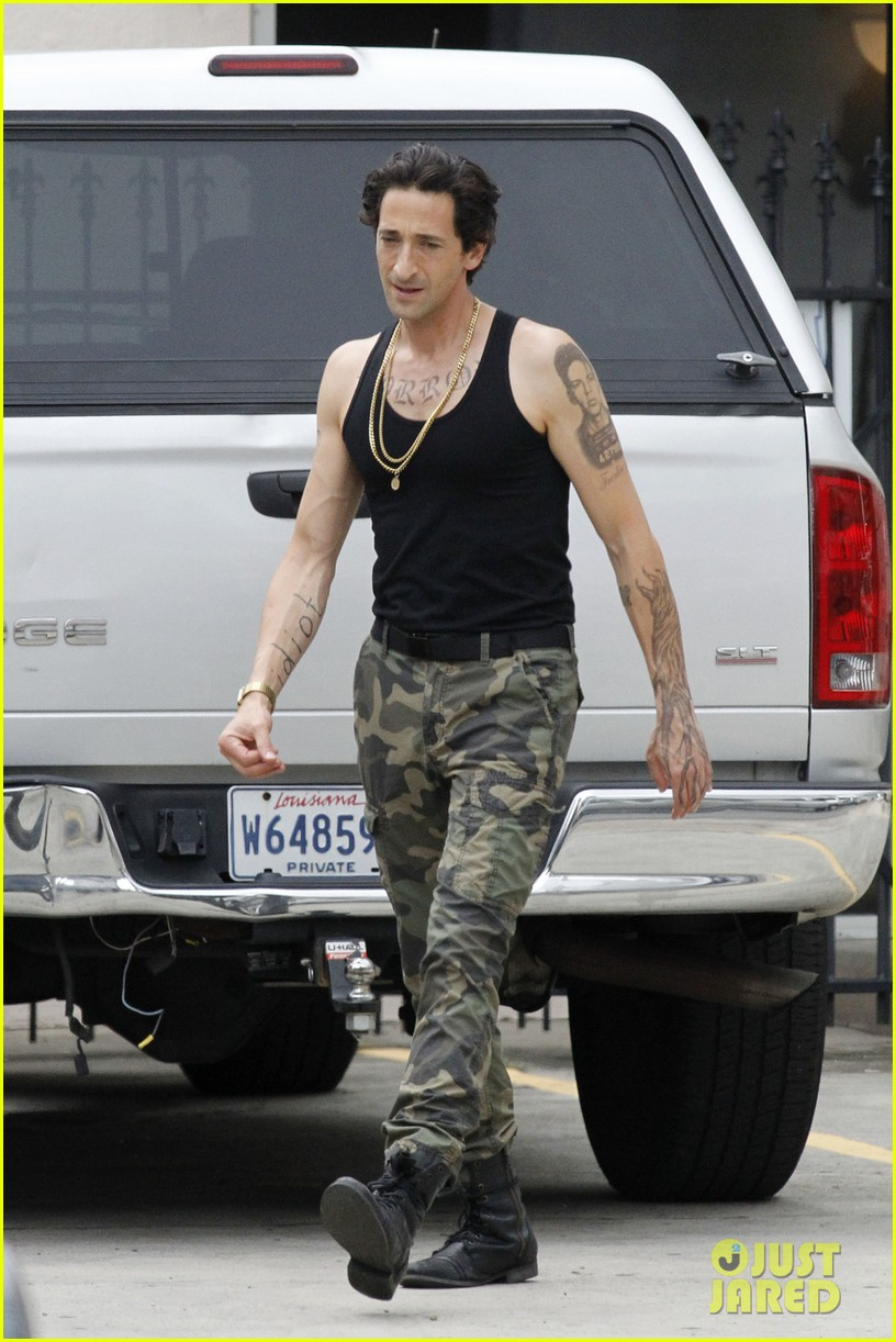 adrien brody sports fake tattoos for american heist 042910325