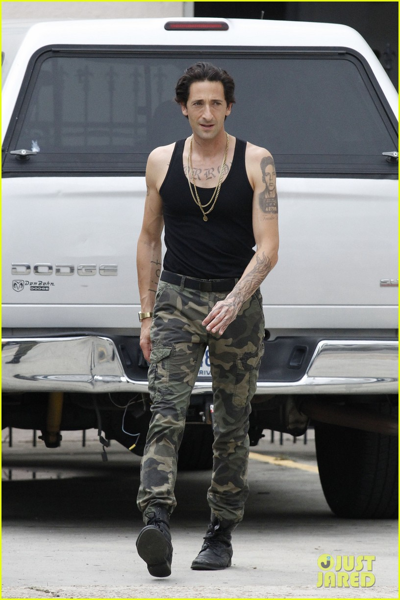 adrien brody sports fake tattoos for american heist 05