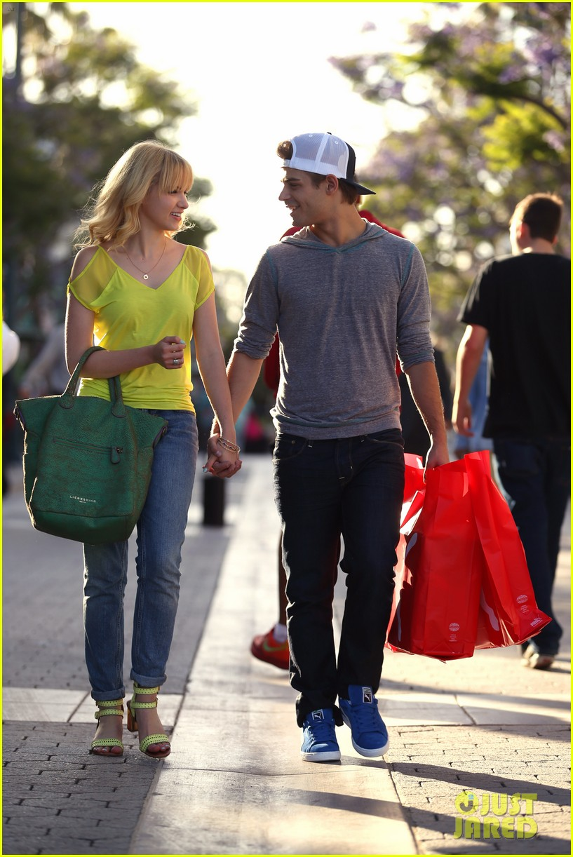 garrett clayton claudia lee holding hands 032916847