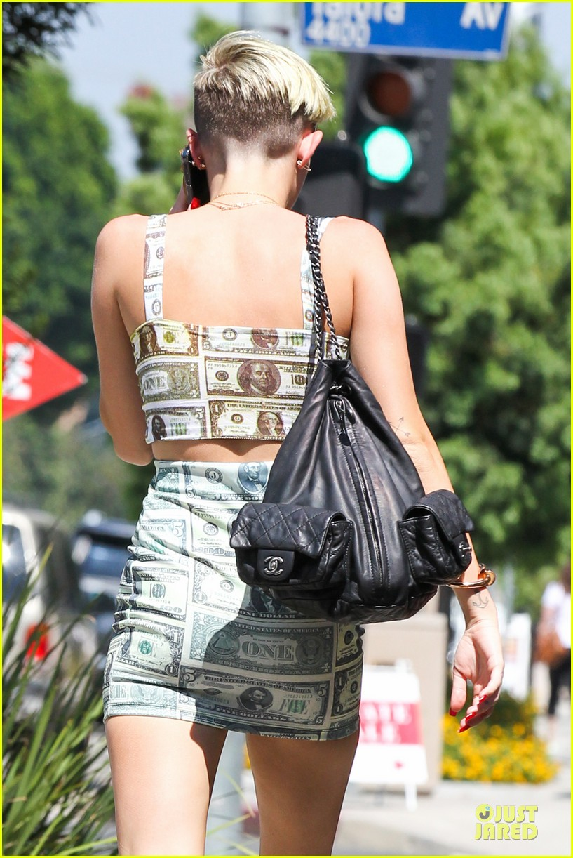miley cyrus bares midriff with money dress 102908626