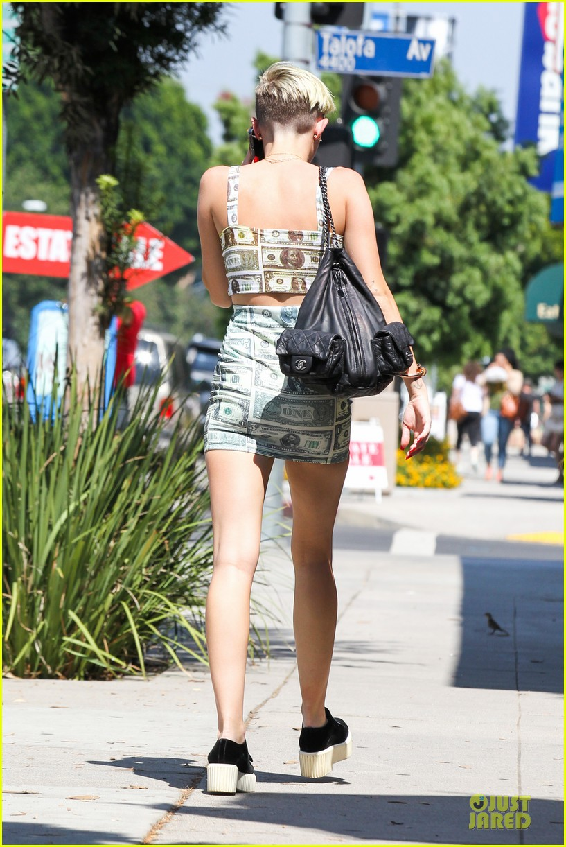 miley cyrus bares midriff with money dress 112908627