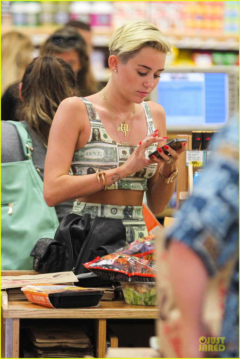 miley cyrus bares midriff with money dress 212908637