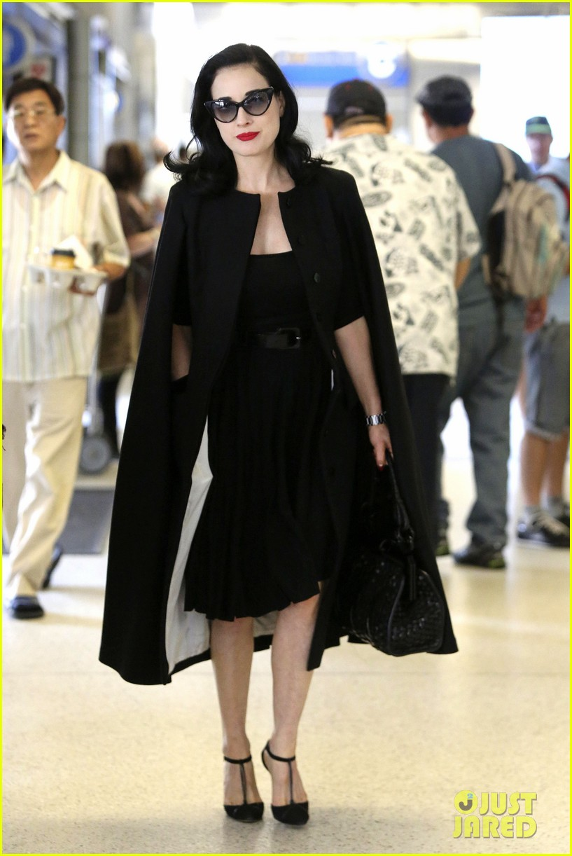 dita von teese wears cape for flight to buenos aires 012912280