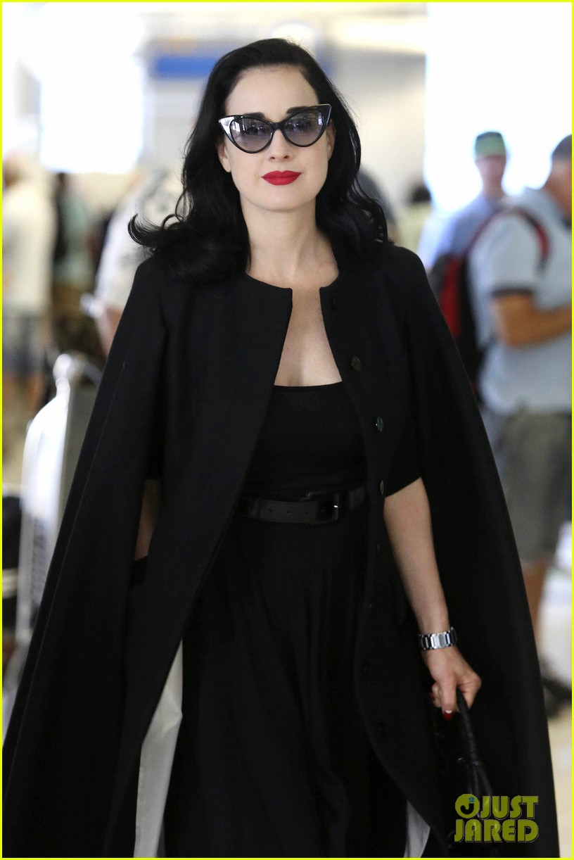 dita von teese wears cape for flight to buenos aires 022912281