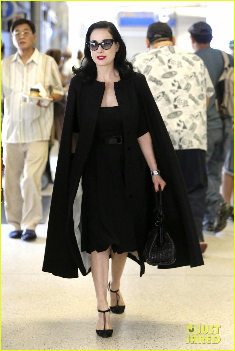 dita von teese wears cape for flight to buenos aires 032912282