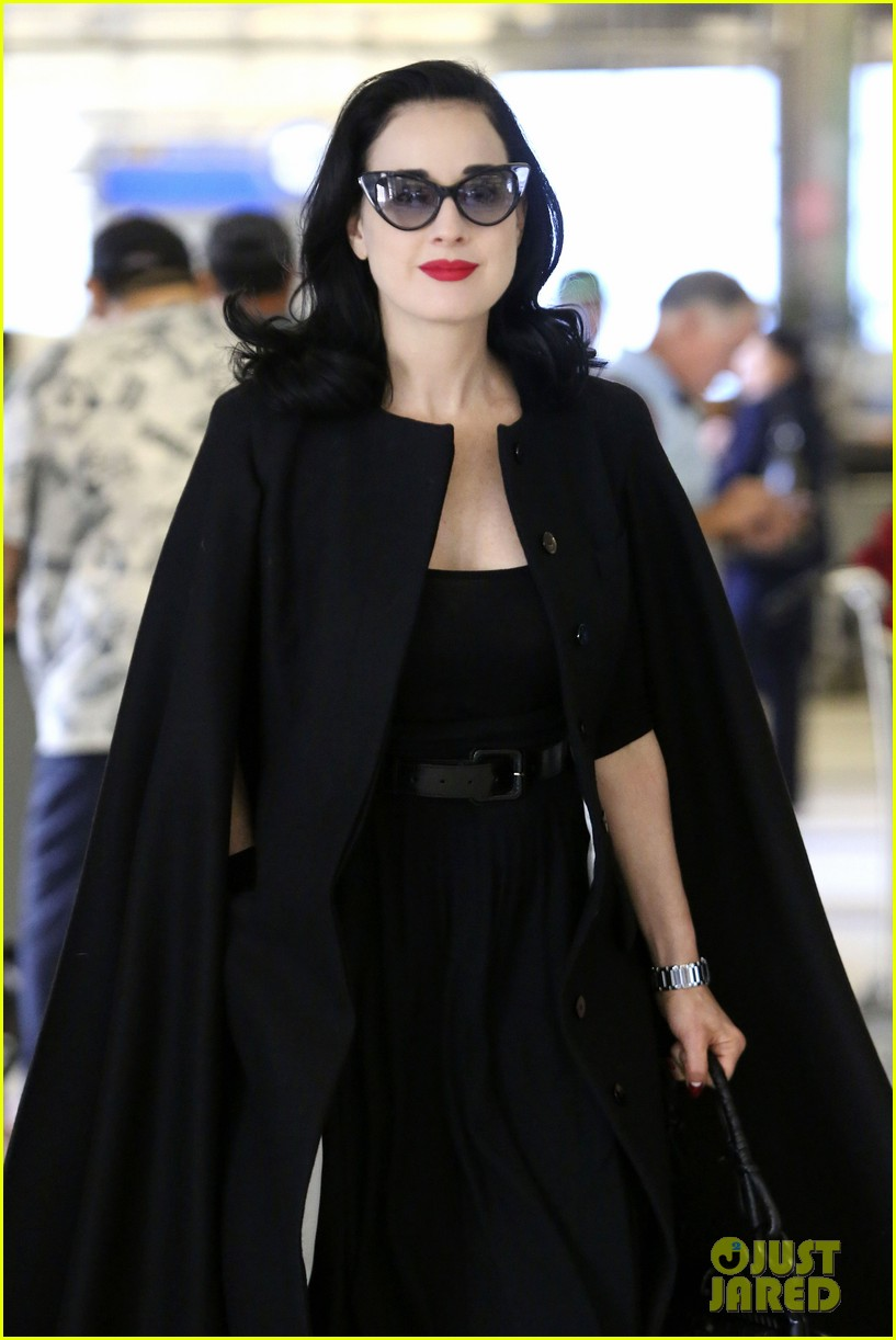 dita von teese wears cape for flight to buenos aires 042912283