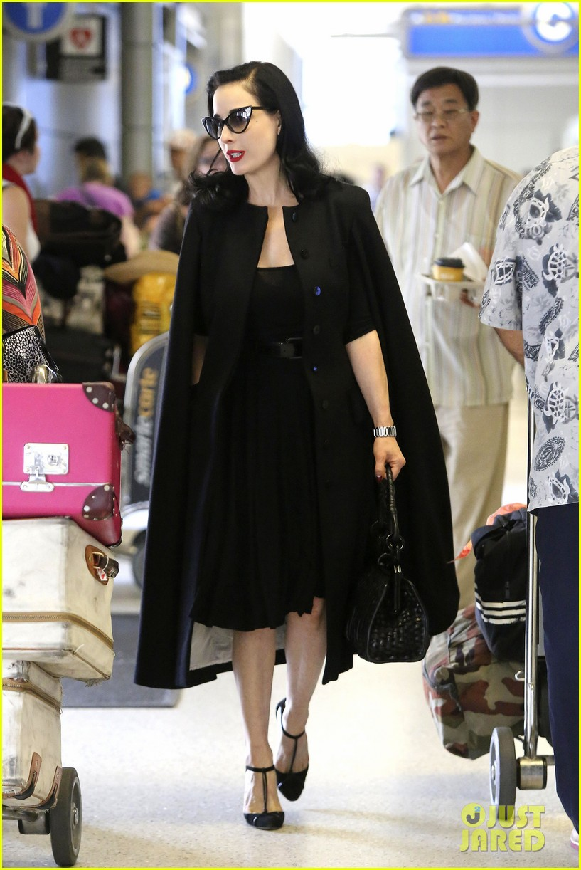 dita von teese wears cape for flight to buenos aires 052912284