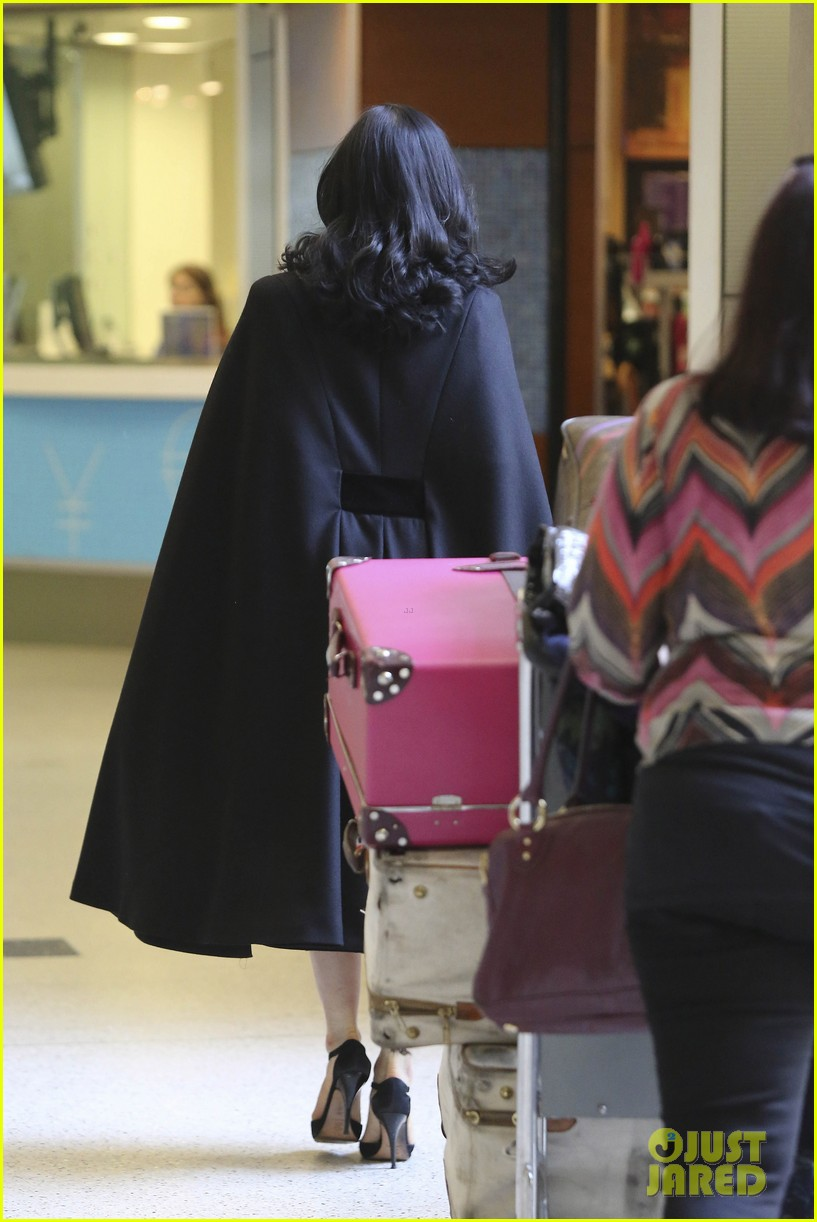 dita von teese wears cape for flight to buenos aires 072912286
