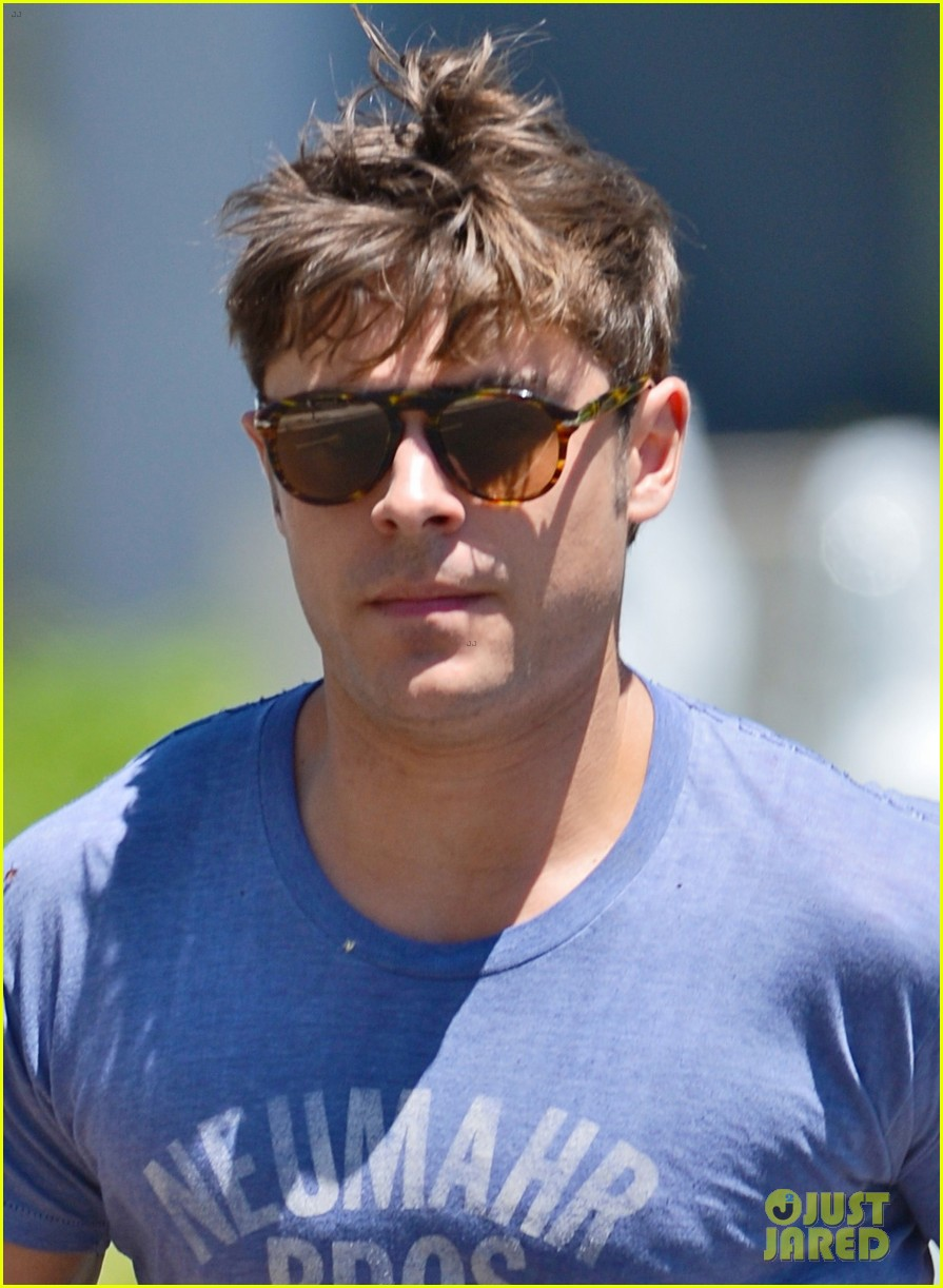 zac efron leaps into action for hotel entrance 032911013