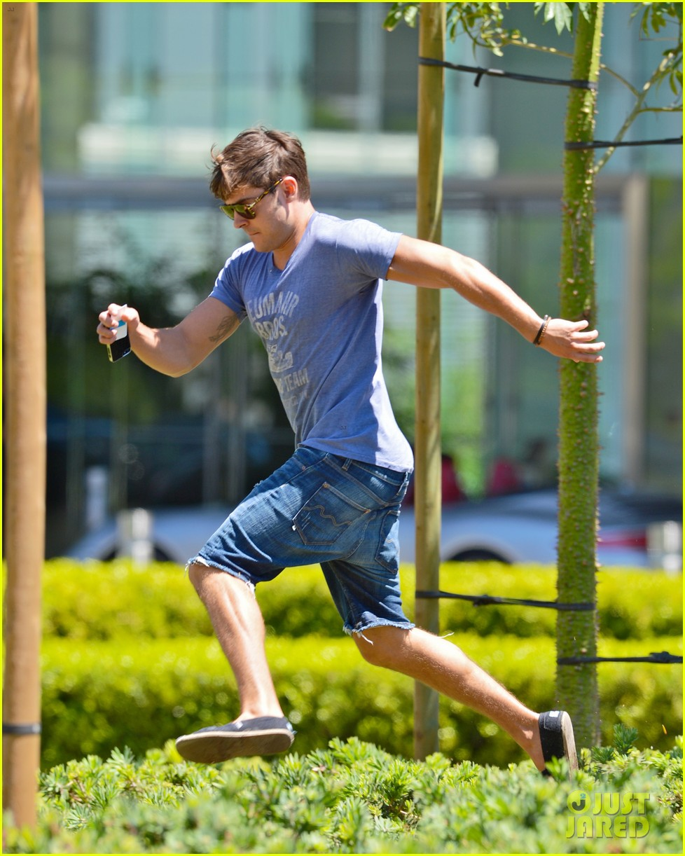 zac efron leaps into action for hotel entrance 042911014