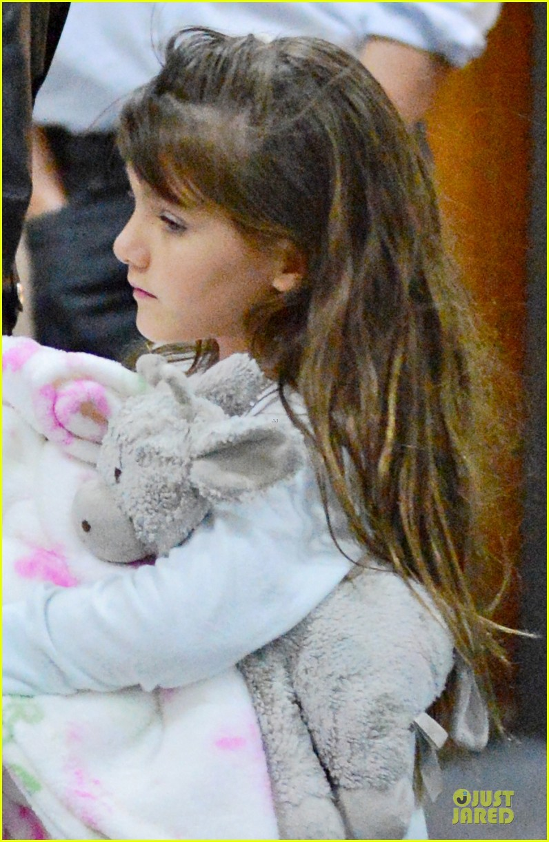 katie holmes suri hold hands after rare lax landing 042914813