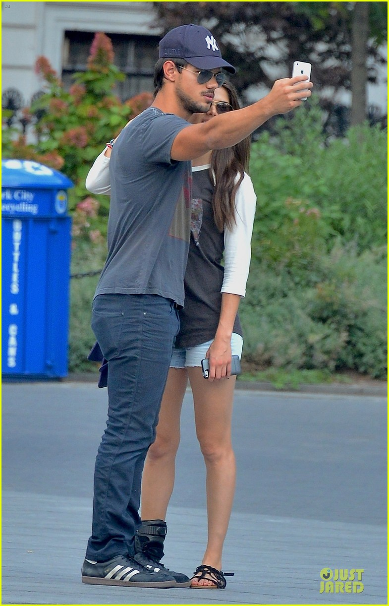 taylor lautner marie avgeropoulos holding hands as new couple 022919665
