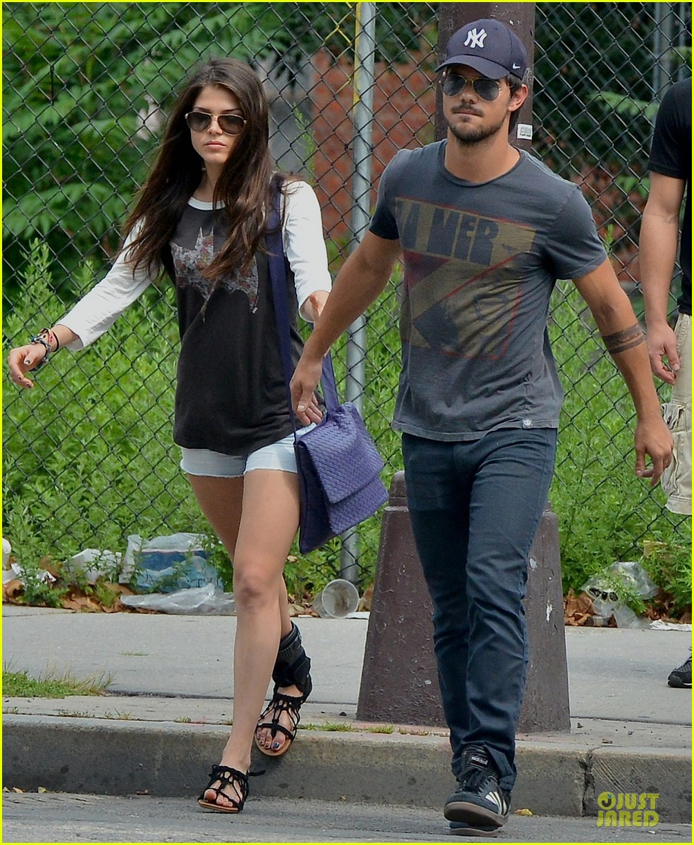 taylor lautner marie avgeropoulos holding hands as new couple 052919668