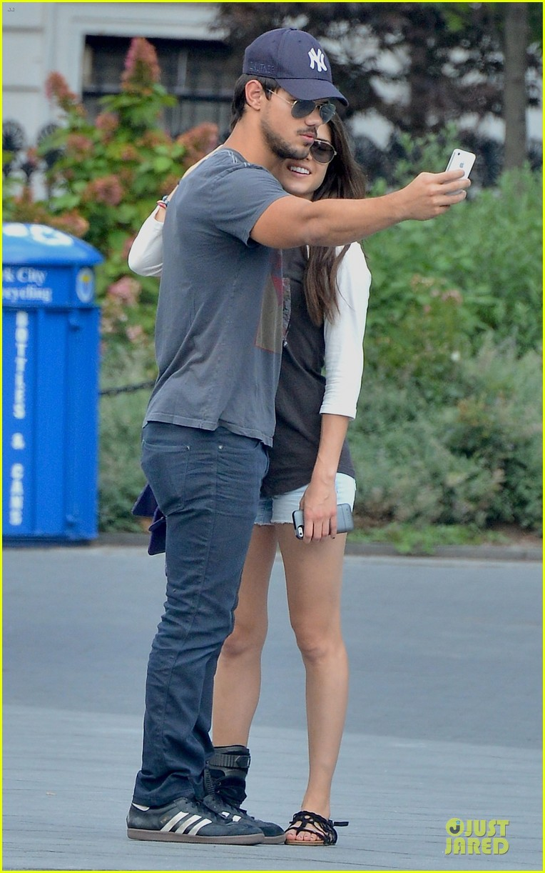 taylor lautner marie avgeropoulos holding hands as new couple 062919669