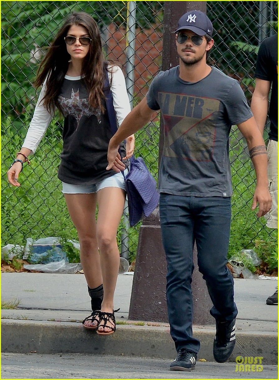 taylor lautner marie avgeropoulos holding hands as new couple 072919670