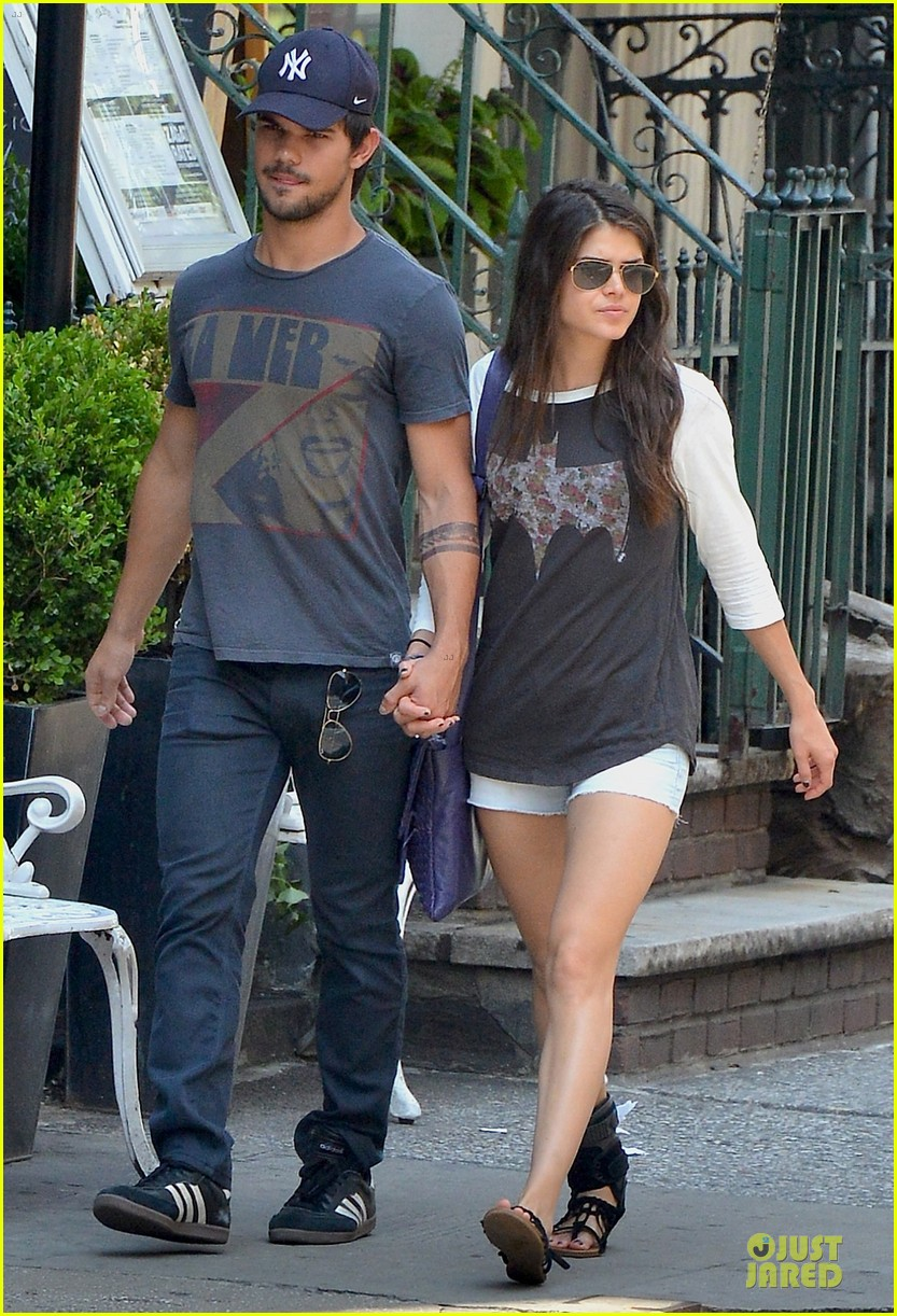 taylor lautner marie avgeropoulos holding hands as new couple 082919671