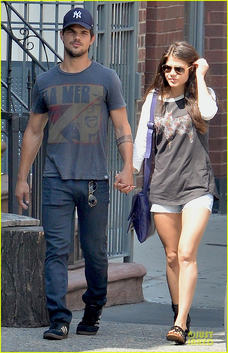 taylor lautner marie avgeropoulos holding hands as new couple 092919672