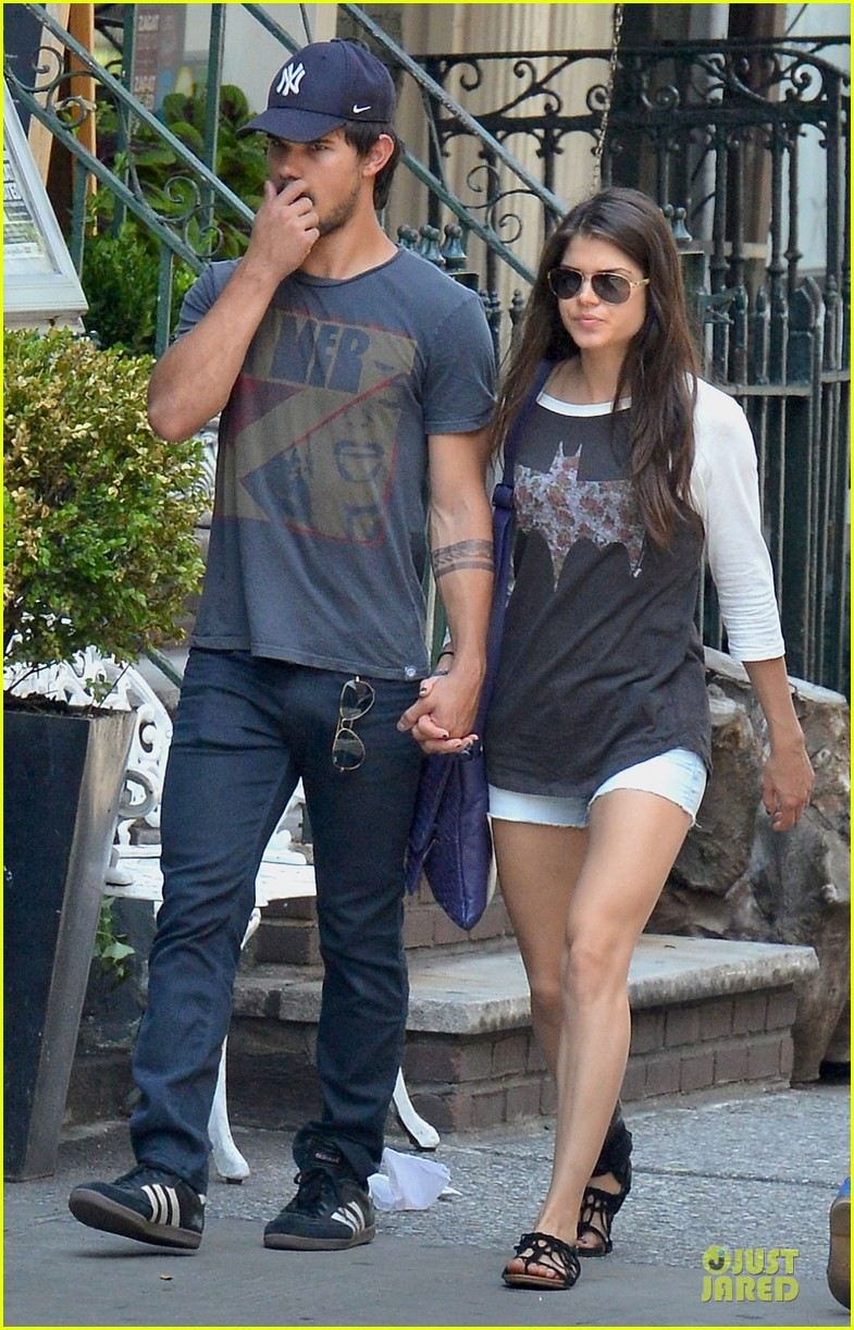 taylor lautner marie avgeropoulos holding hands as new couple 112919674
