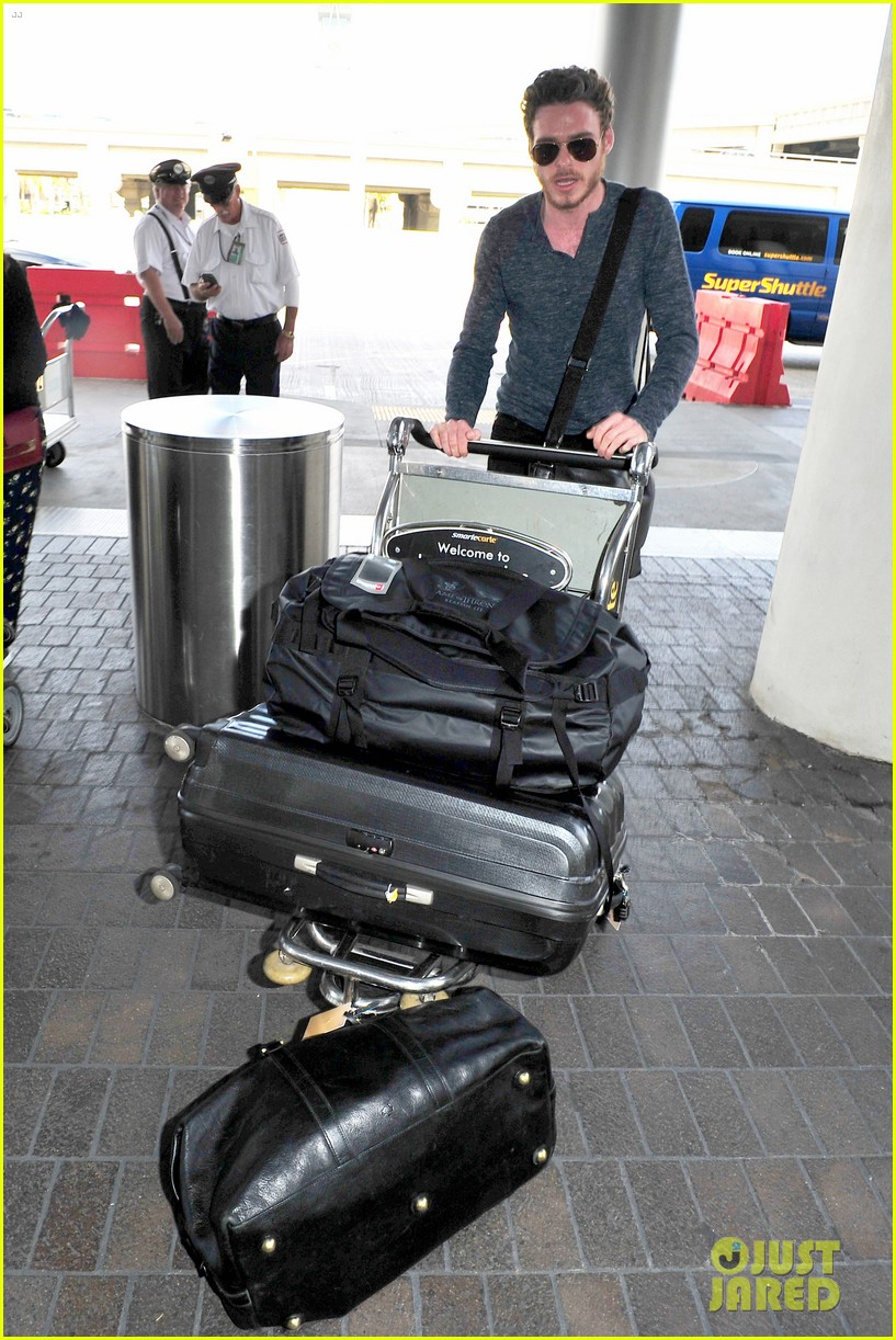 richard madden jenna coleman lots of luggage at lax 112917828