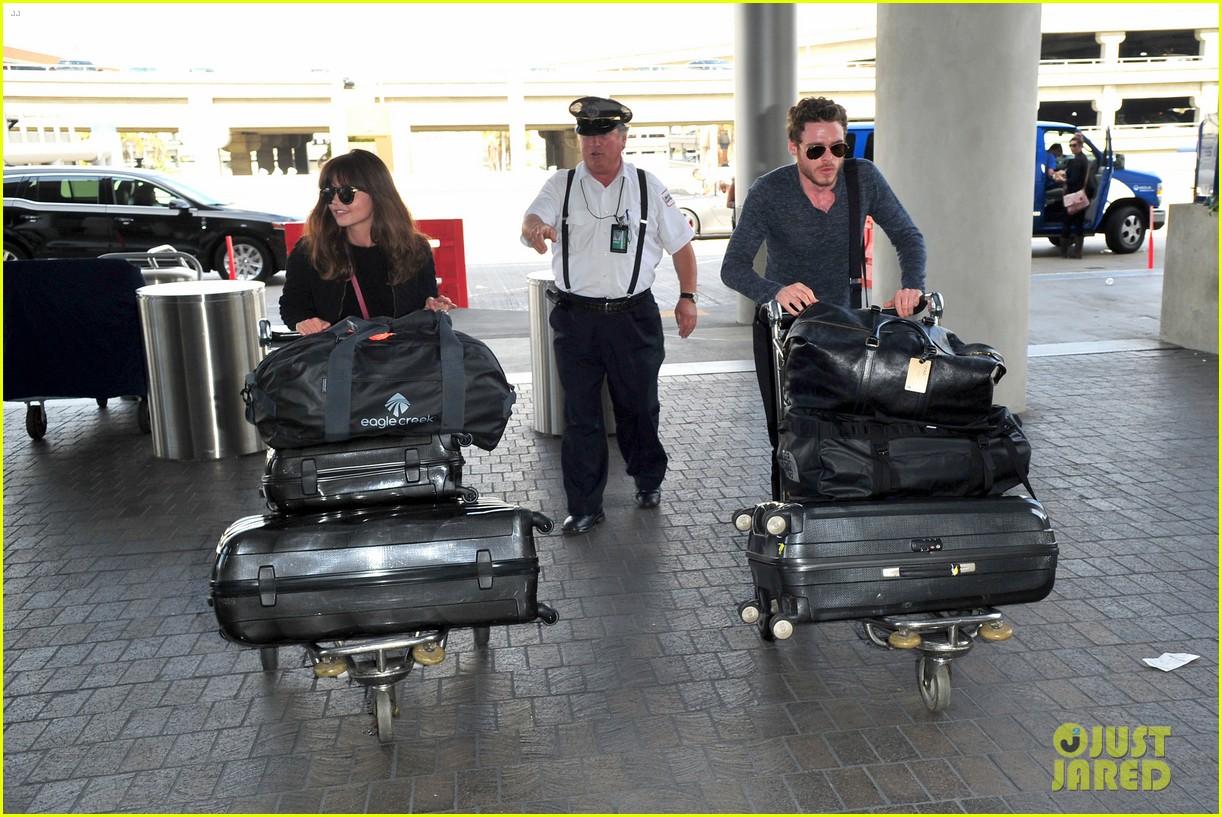 richard madden jenna coleman lots of luggage at lax 152917832
