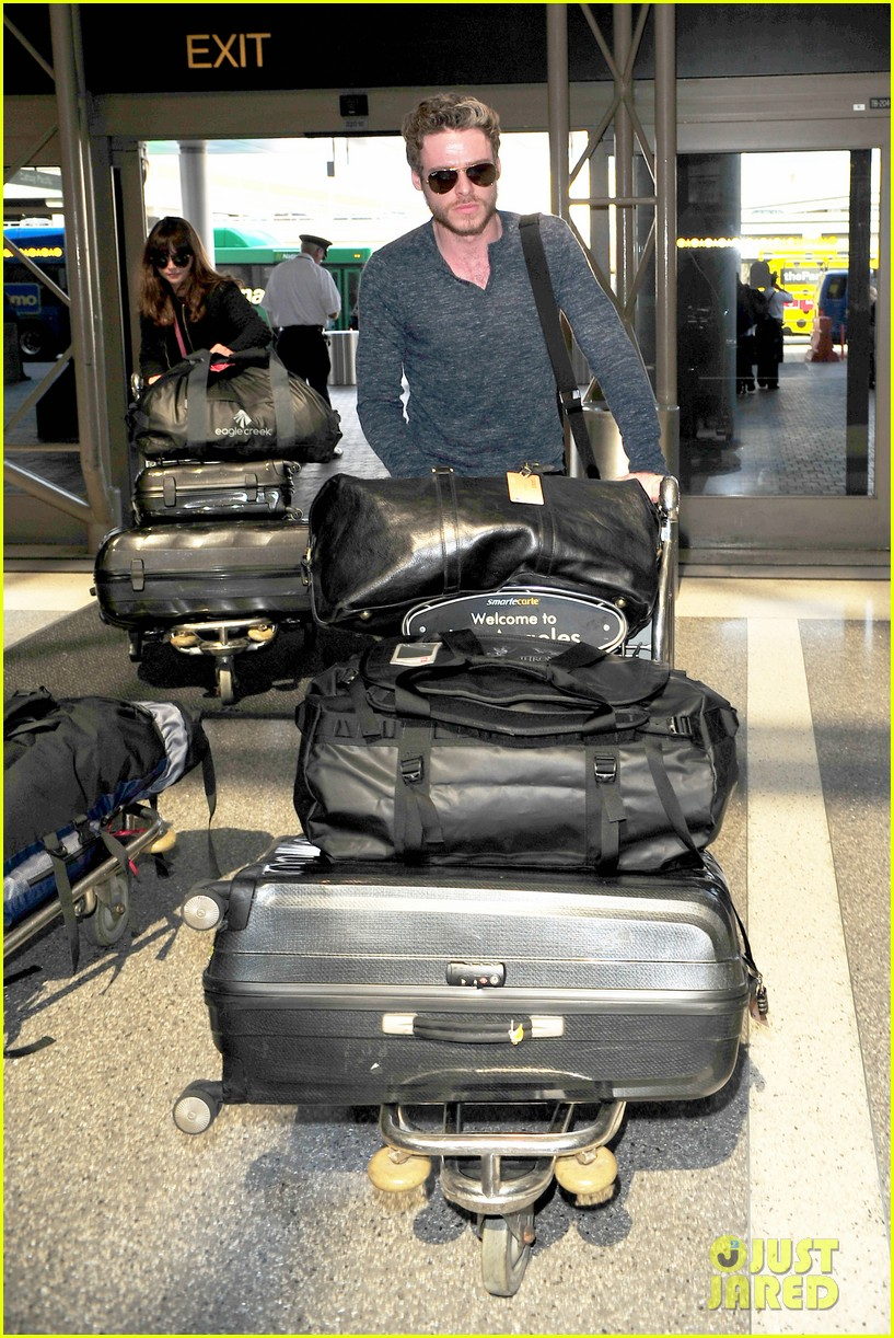 richard madden jenna coleman lots of luggage at lax 252917842