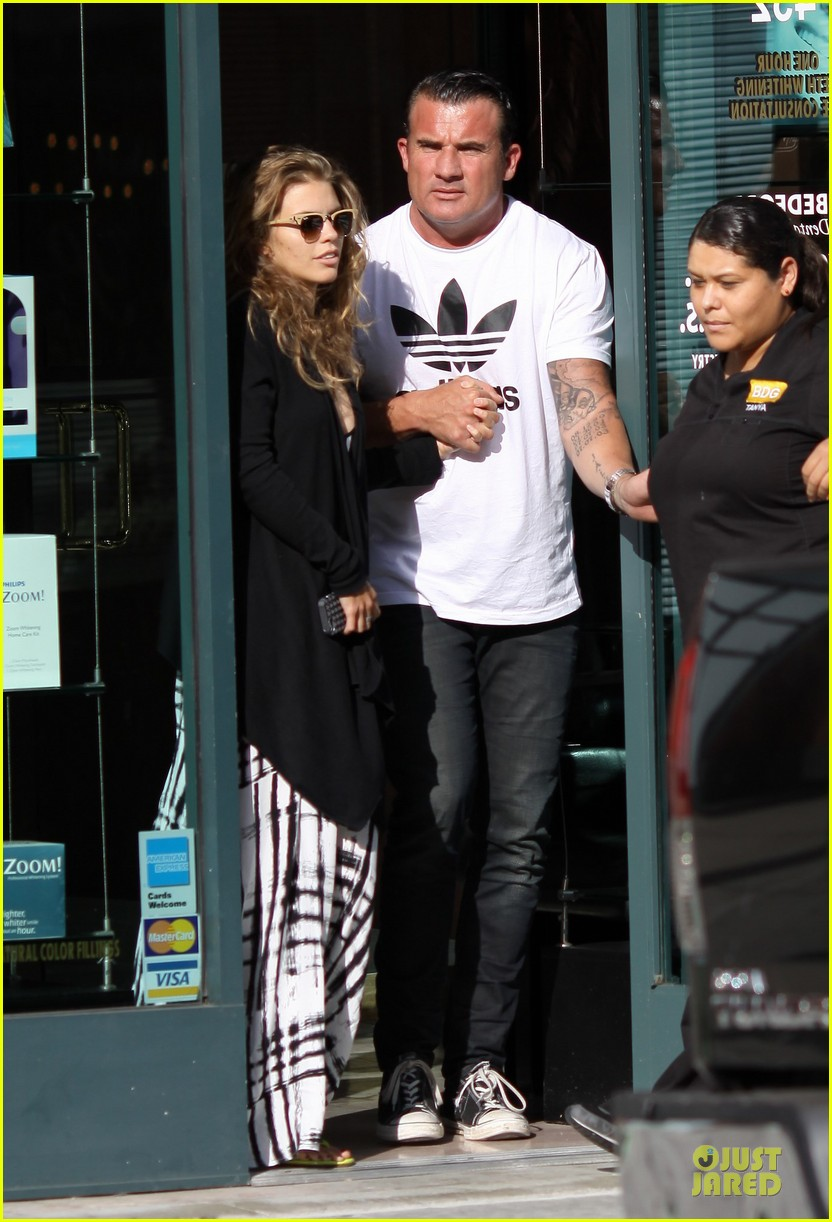 annalynne mccord dominic purcell hold hands at the dentist 01