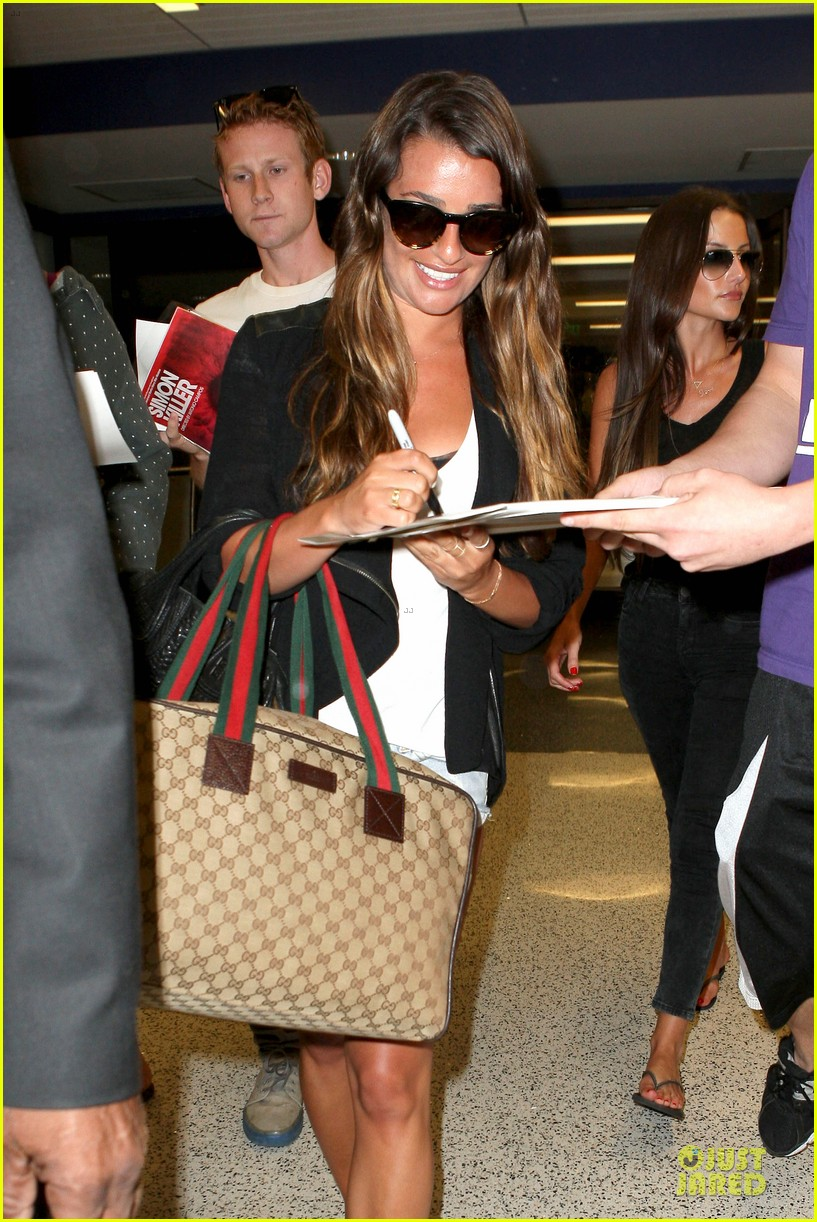 lea michele lax arrival after bikini clad vacation 04