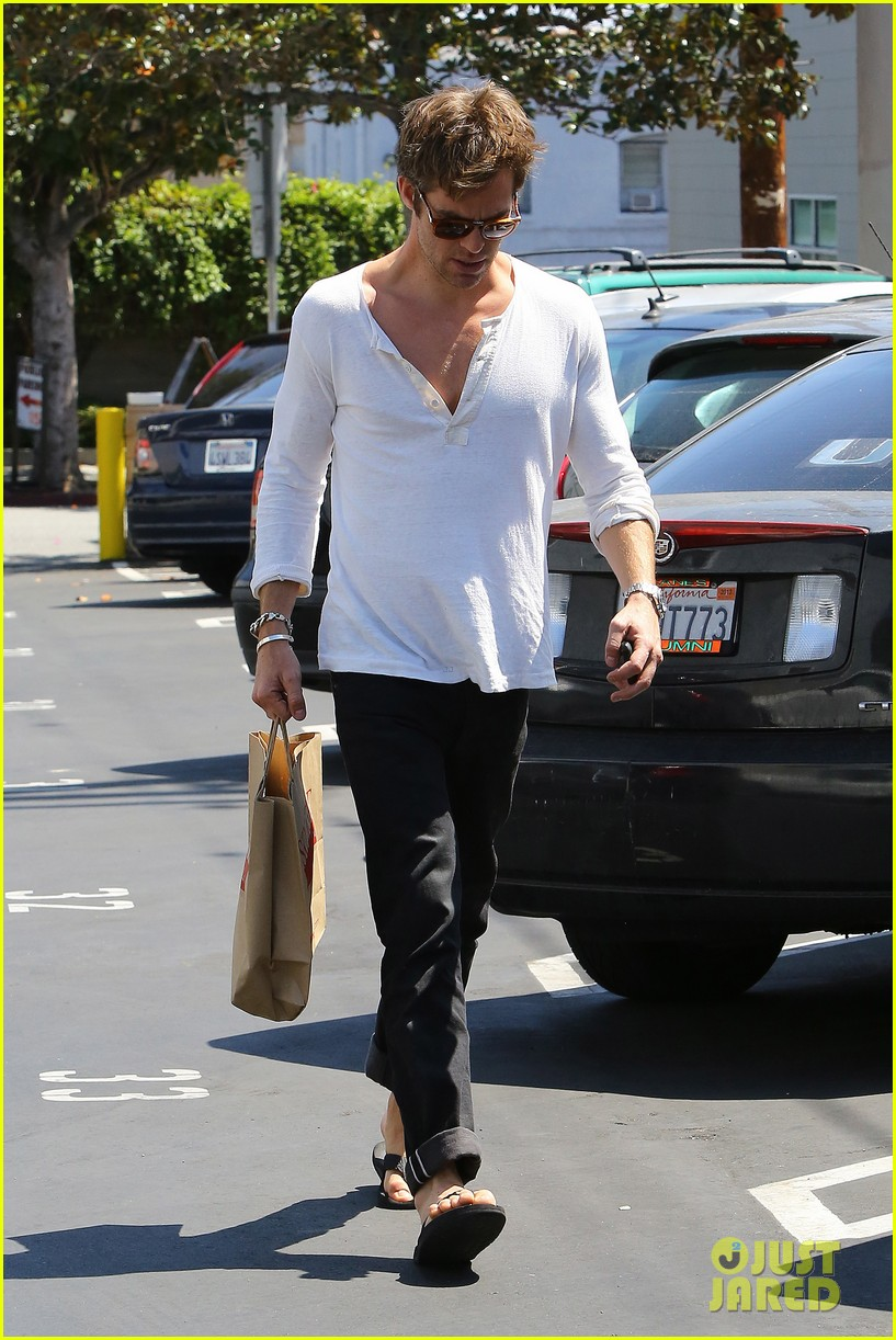 chris pine shows some skin in unbottoned henley 03