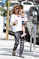 ellen pompeo showcases arm strength with stella 08