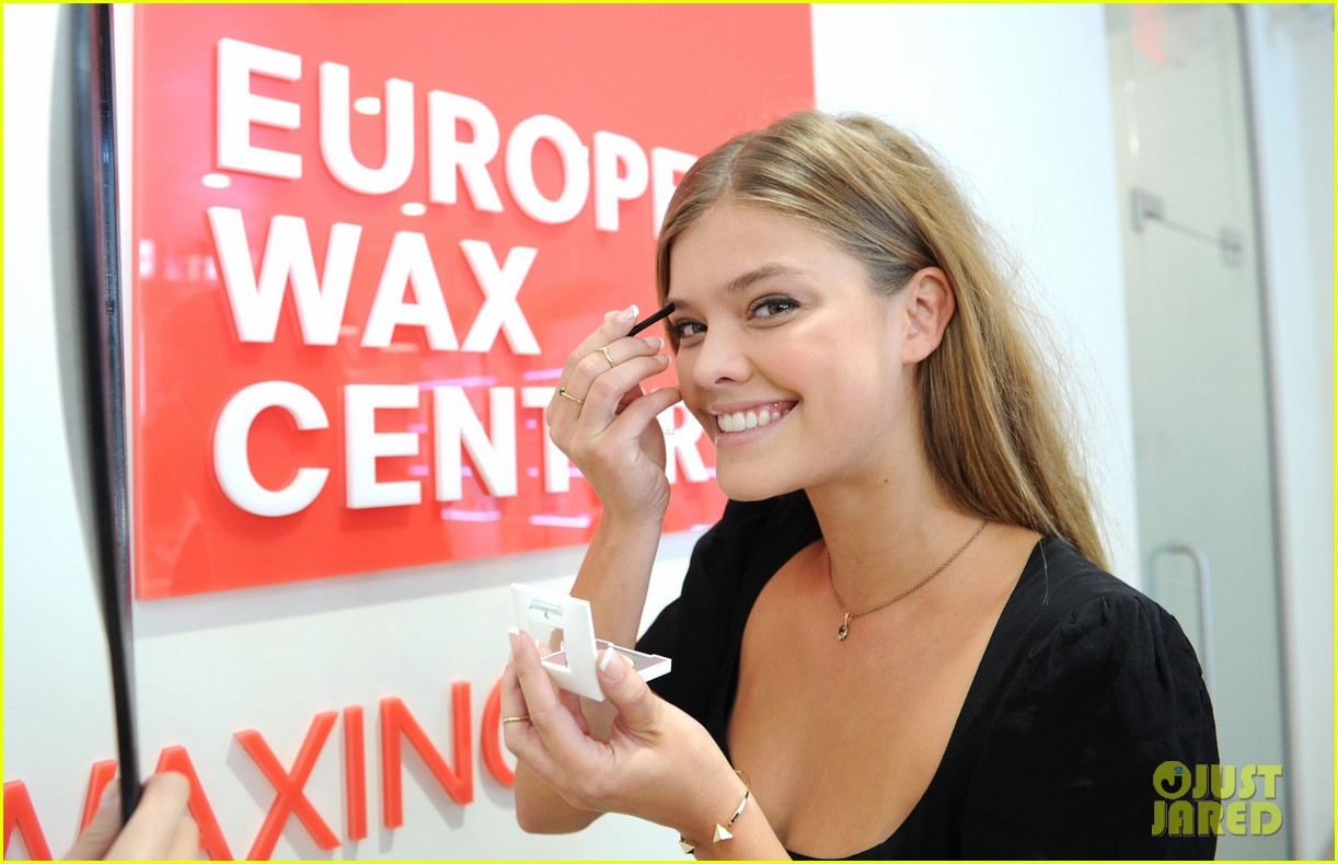 nina adgal tends to her brows at the european wax salon 032930119