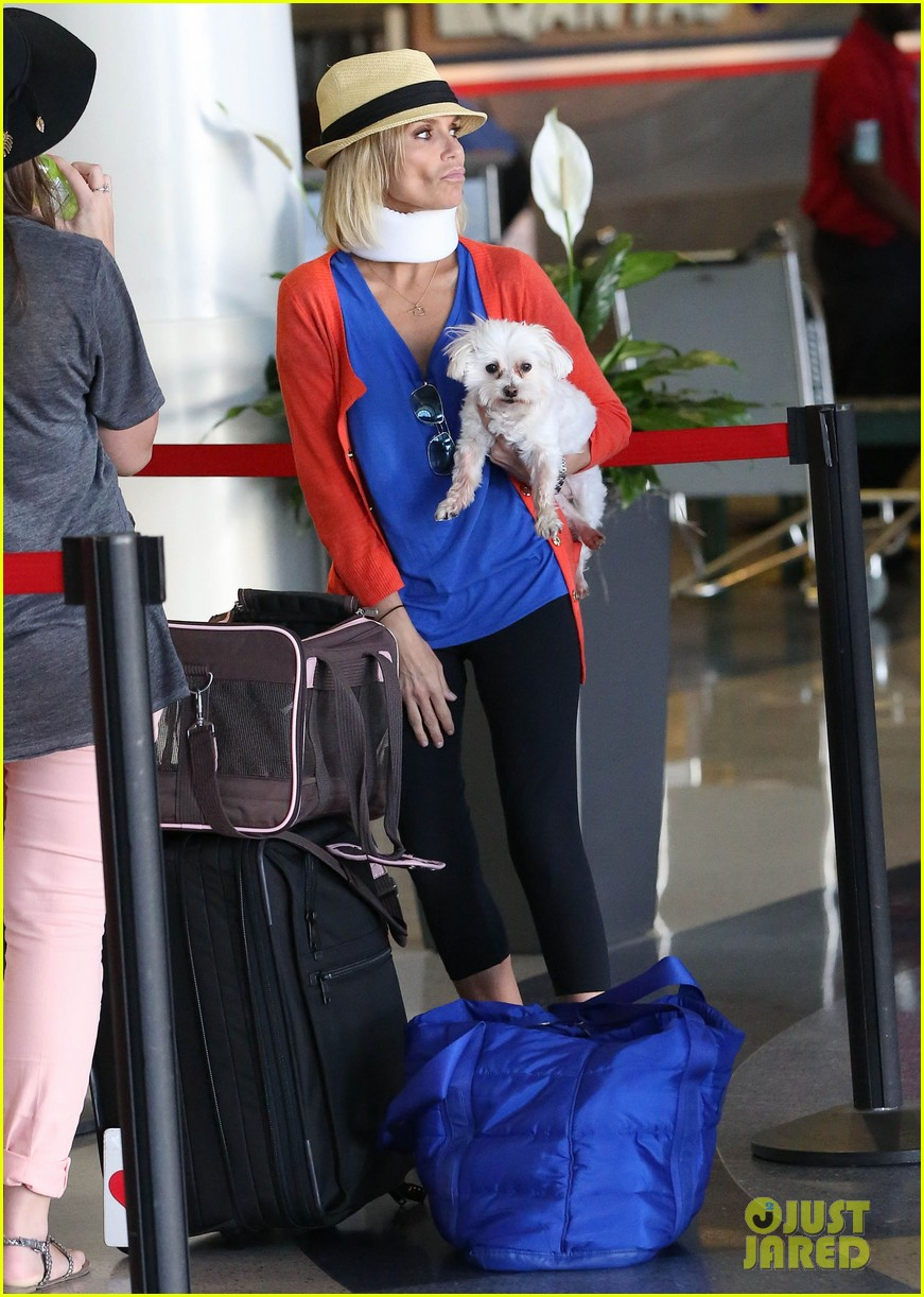 kristin chenoweth wears neck brace for flight to miami 082927216