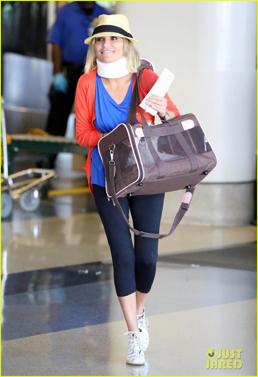 kristin chenoweth wears neck brace for flight to miami 112927219