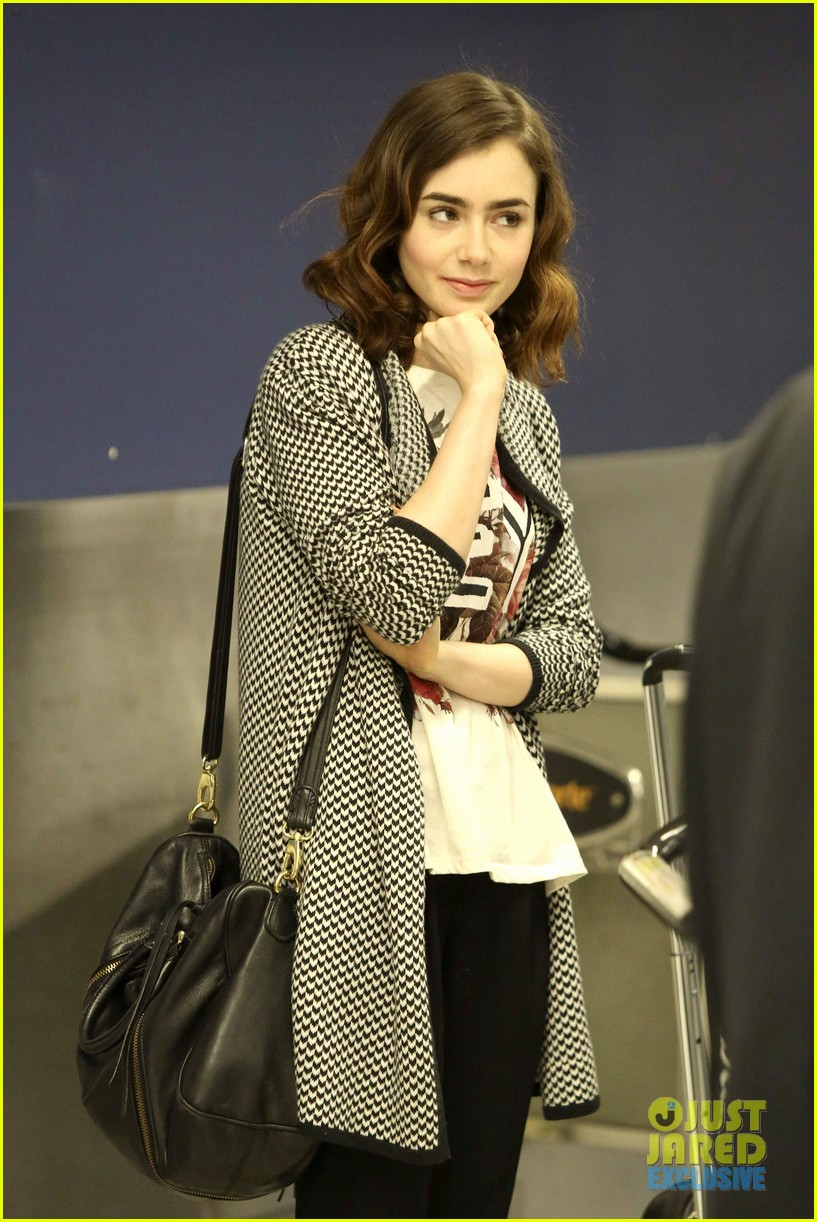 lily collins pushes giant luggage cart after mortals tour 072939608