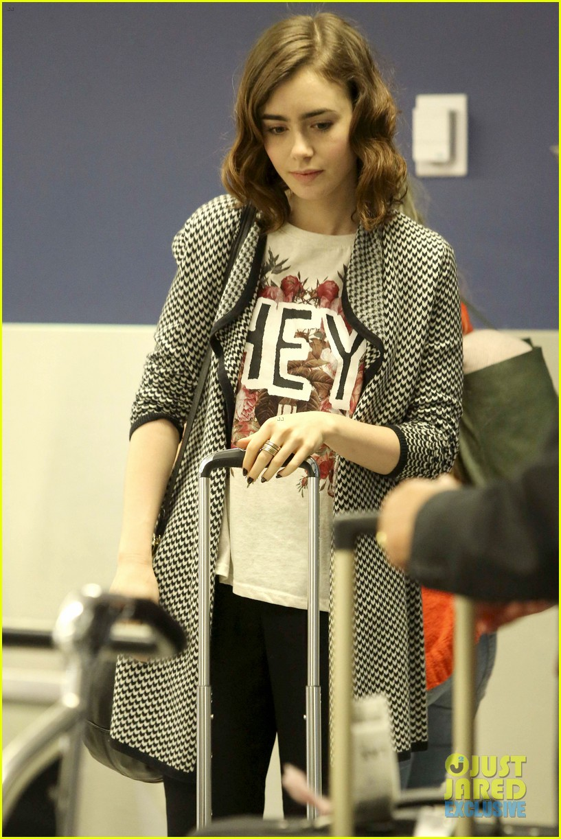 lily collins pushes giant luggage cart after mortals tour 132939614