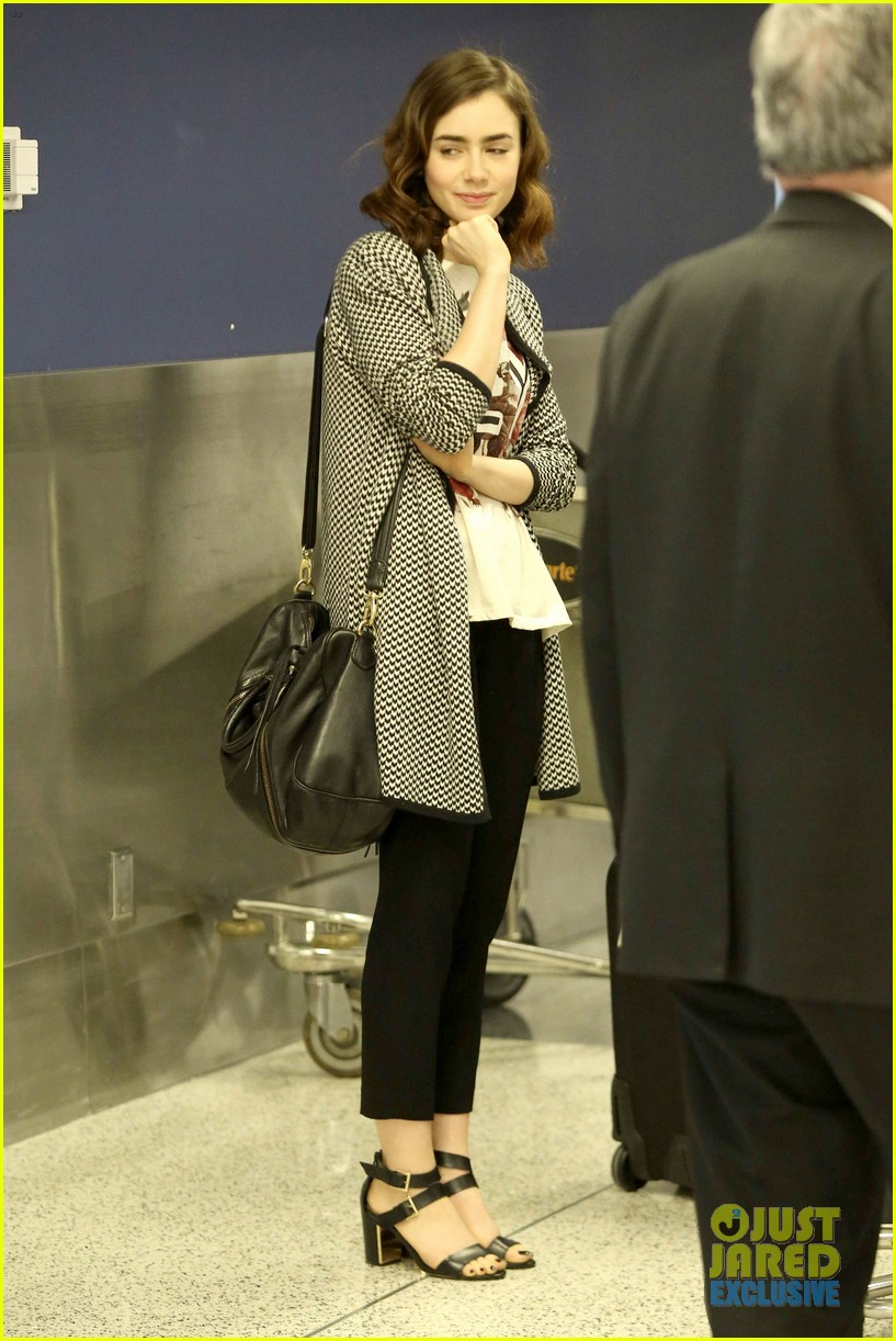 lily collins pushes giant luggage cart after mortals tour 142939615