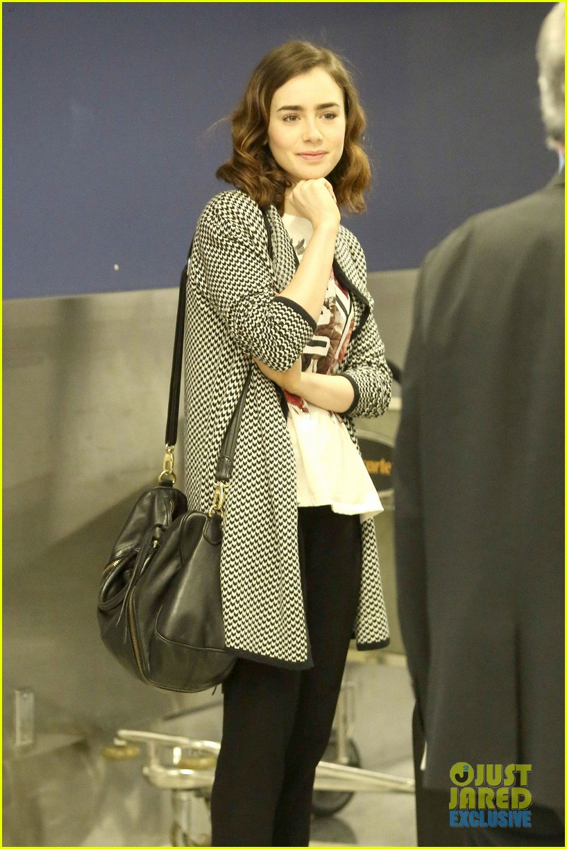 lily collins pushes giant luggage cart after mortals tour 212939622