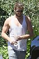 liam hemsworth bares buff biceps goes barefoot 10