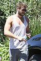 liam hemsworth bares buff biceps goes barefoot 11
