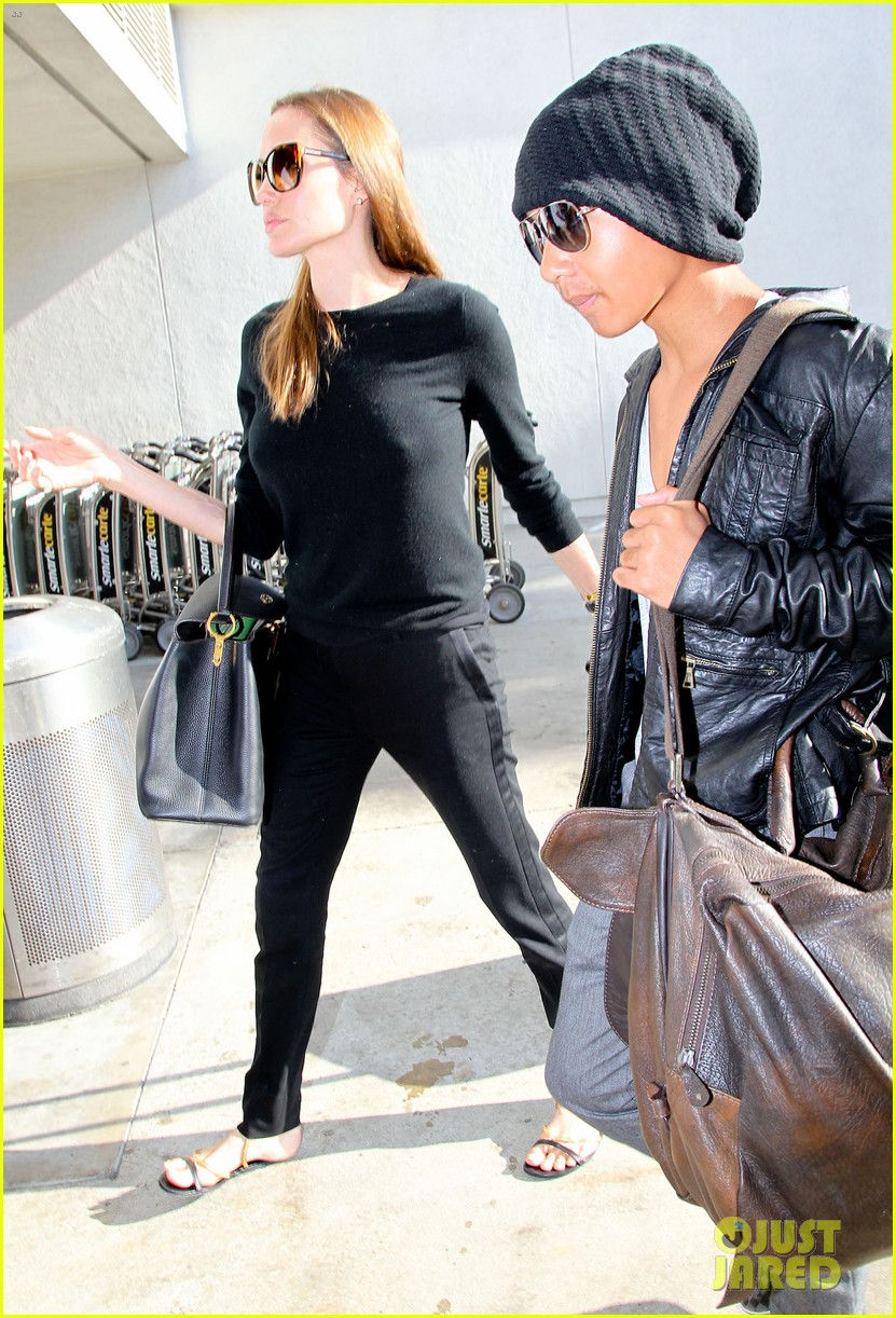 angelina jolie lands in los angeles with maddox 16