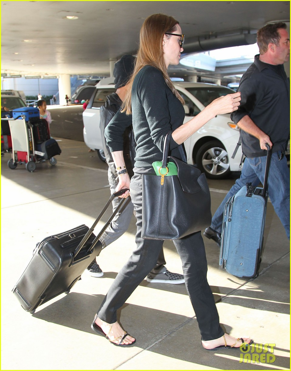 angelina jolie lands in los angeles with maddox 182931044
