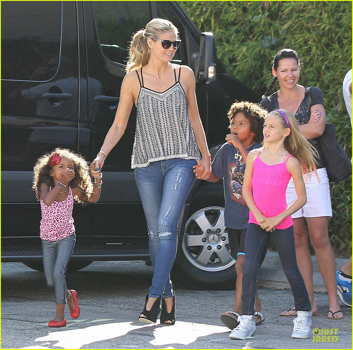 heidi klum martin kirsten beach bike ride with kids 112938445
