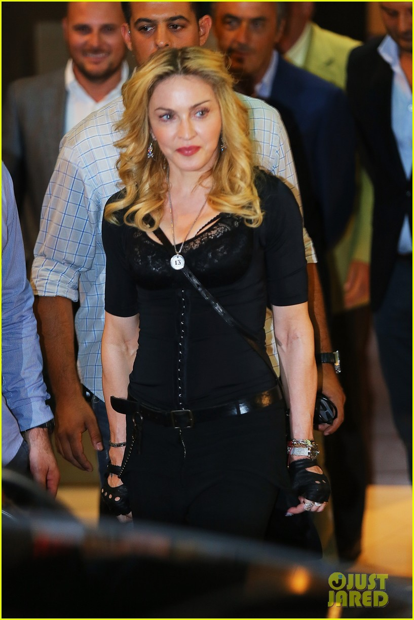 madonna rocks gold grills at the hard candy fitness center 102935303